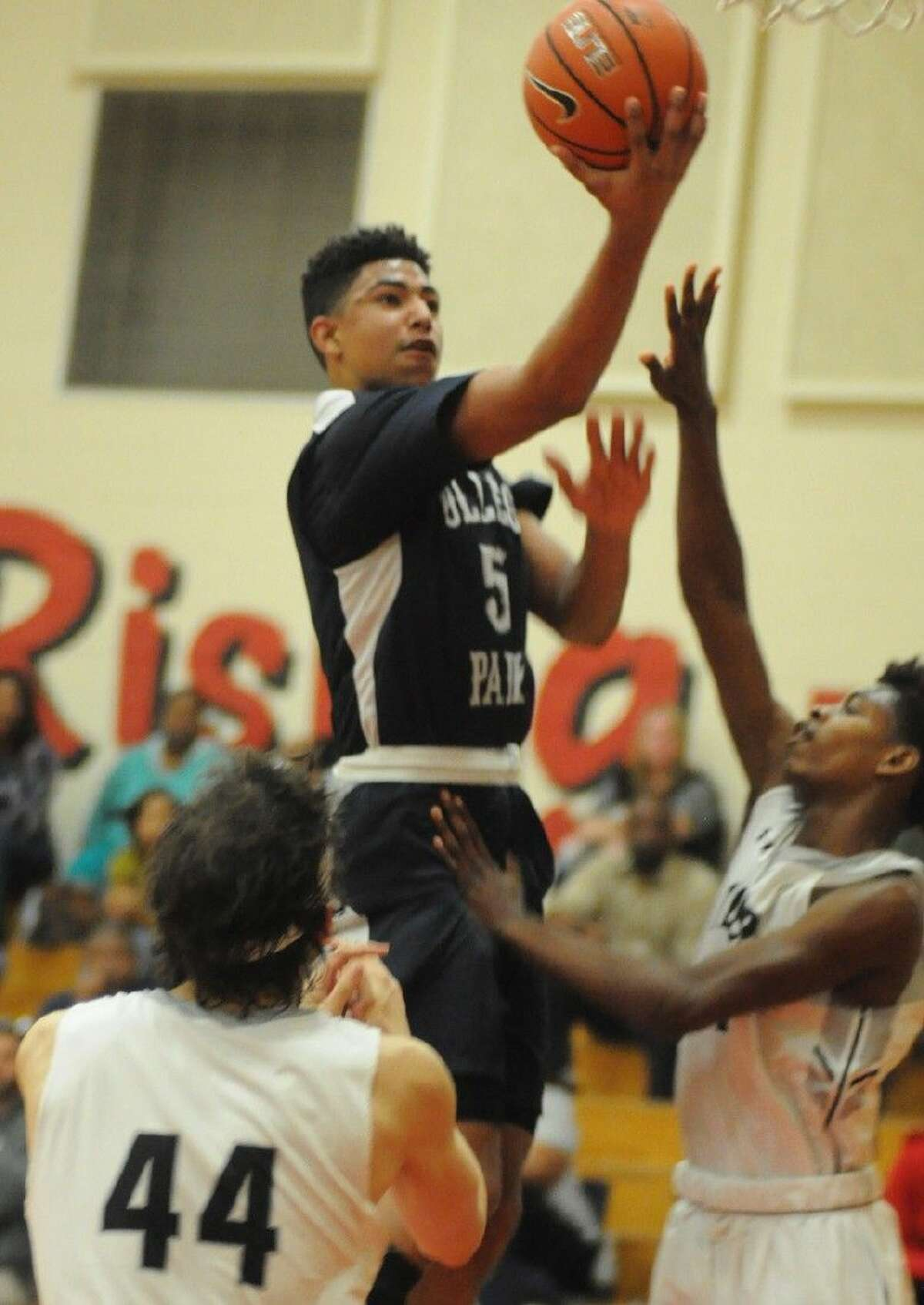College Park's Quentin Grimes goes up for a layup in a District 16-6A play-in game against Conroe at Caney Creek High School on Saturday.