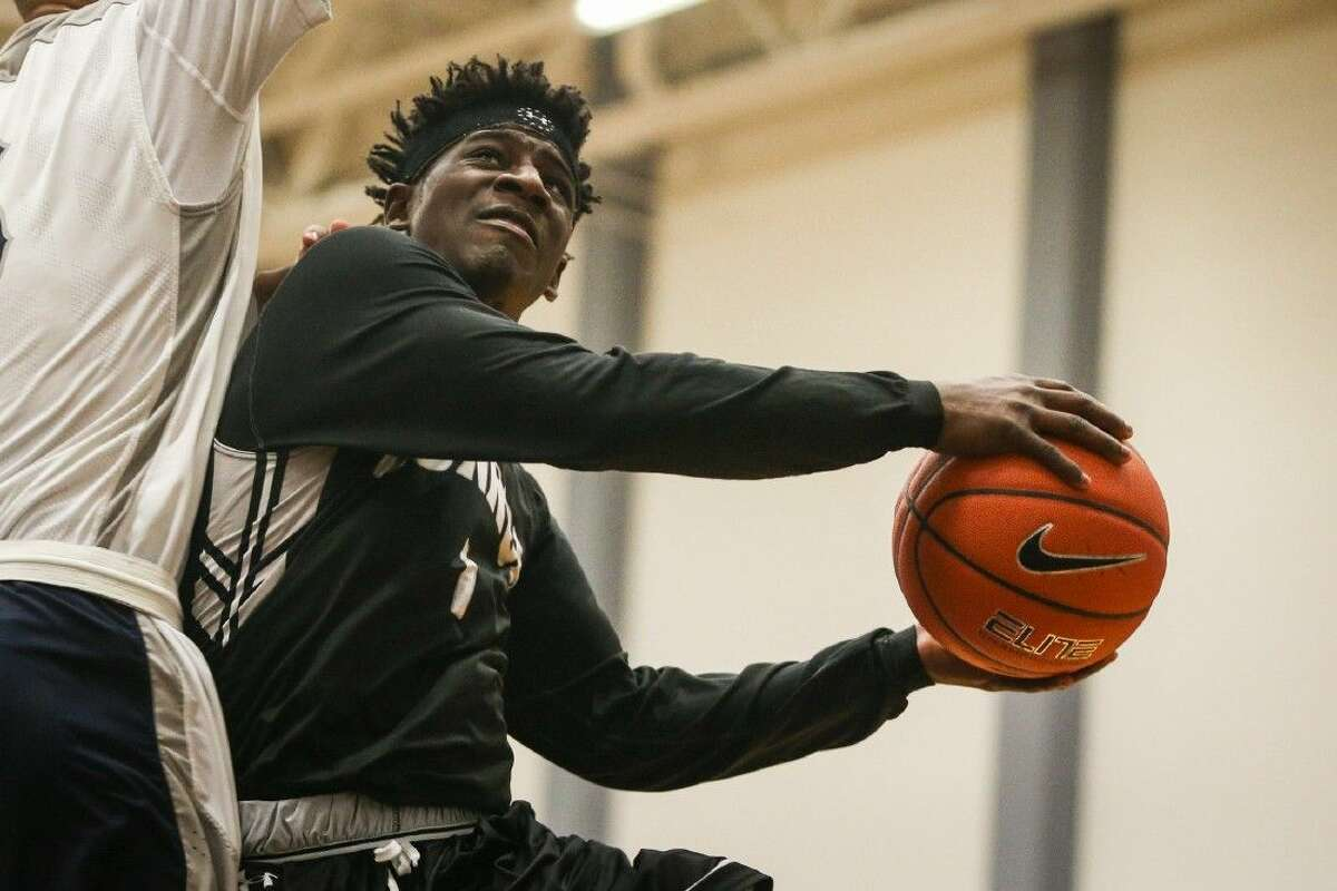 Conroe sophomore Jay Lewis (1) drives to the hoop last Tuesday against College Park.