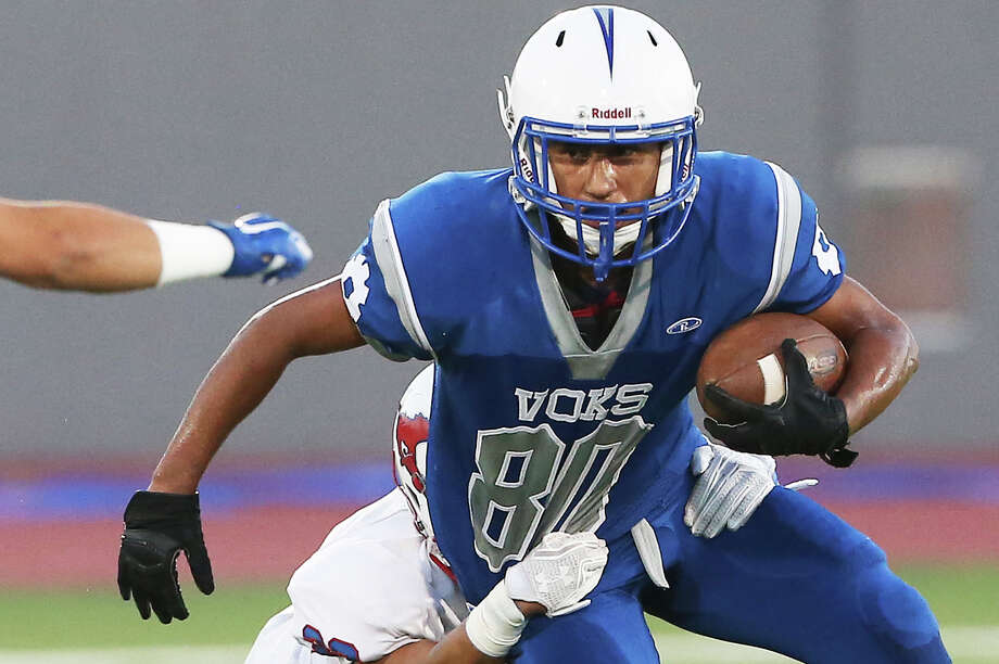 Damian Tovar makes a good gain for the Voks but is hauled down by Nathan Rodriguez as Jefferson plays Lanier at Alamo Stadium on Sept. 29, 2016. Photo: Tom Reel /San Antonio Express-News / 2016 SAN ANTONIO EXPRESS-NEWS