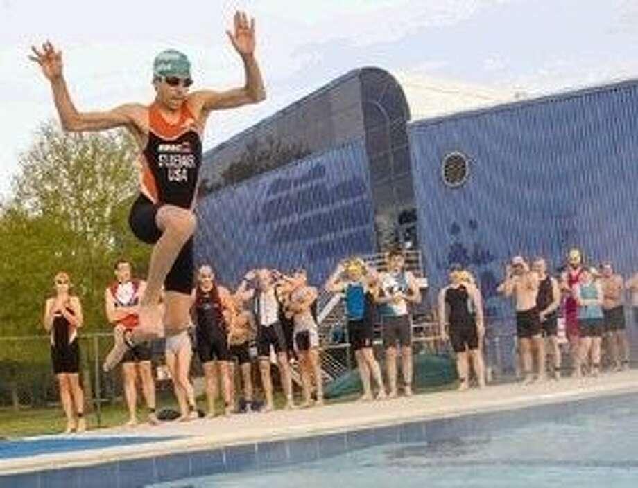 Nicholas Studebaker jumps into a pool during the third annual Conroe YMCA Tri-for-Fun triathlon. Photo: Staff Photo By Ana Ramirez