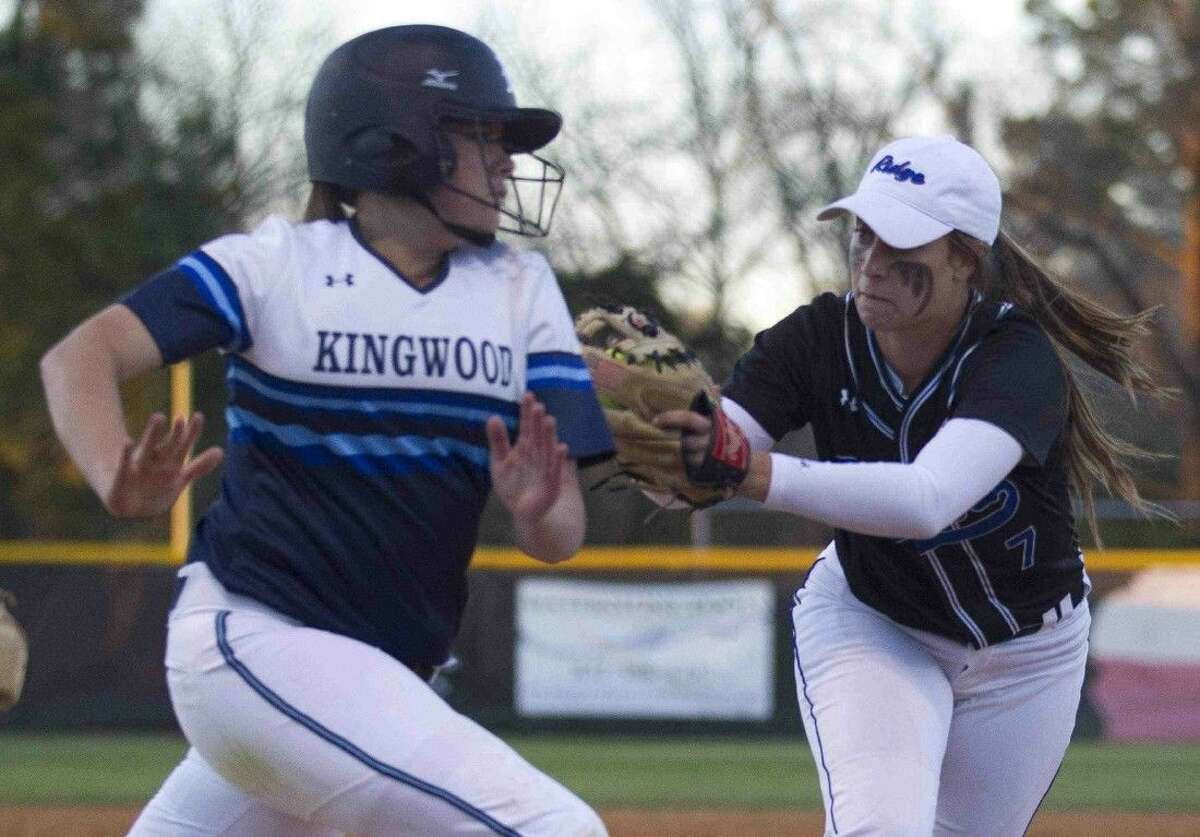 Oak Ridge first baseman Kylie Hunt tags out Kingwood runner Kate Ryan in the second inning of a District 16-6A softball game Wednesday.