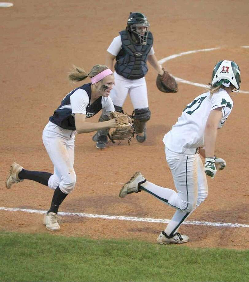 College Park third baseman Julie French chases The Woodlands' Amy Cimera during a District 14-5A game on Tuesday. The Lady Highlanders won 3-1. To view or purchase this photo and others like it, visit HCNpics.com. Photo: Jason Fochtman