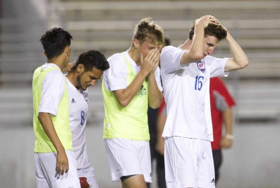 Oak Ridge players react after losing to Westfield 1-0 in extra time during a Region II-6A bi-district playoff game Thursday. To view or purchase this photo and others like it, visit HCNpics.com.