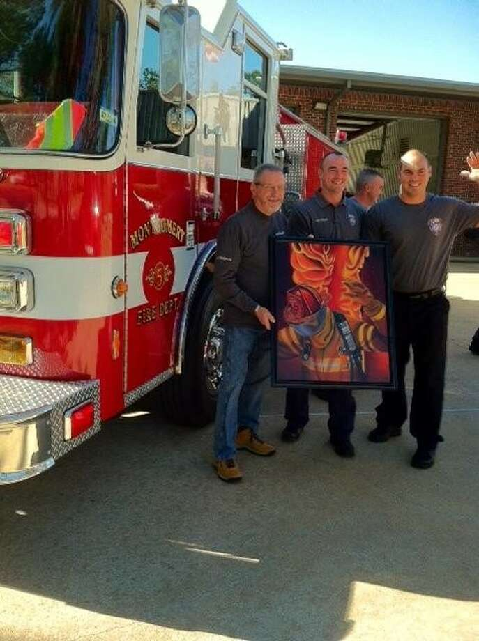 "Conroe Art League member Bob Shepherd donated his oil painting, ""Come On Men"" to Montgomery County Fire Station #55 to two station officials Tuesday. From left to right are artist Bob Shepherd, and two fire station officials, Jacob Hoffart (center) and Justin Andrew."