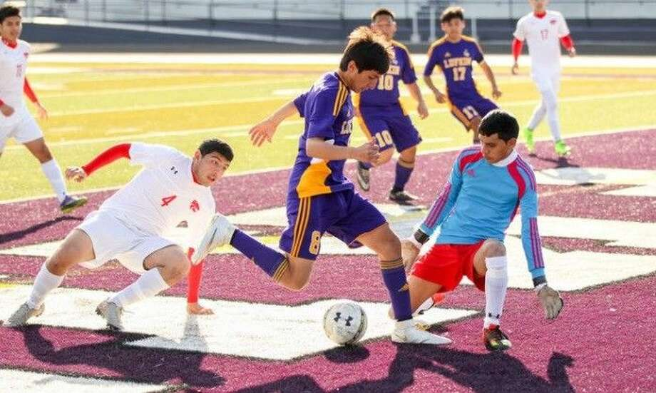 Splendora's Andres Garcia (4) and goalkeeper Joel Santos defend against Lufkin in a match earlier this season.