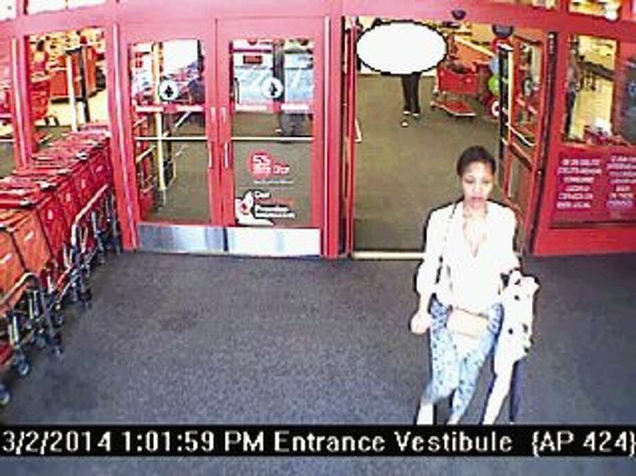 Surveillance photos show a woman police are trying to identify who allegedly used stolen credit/debit card information to purchase items at a Conroe Target store.