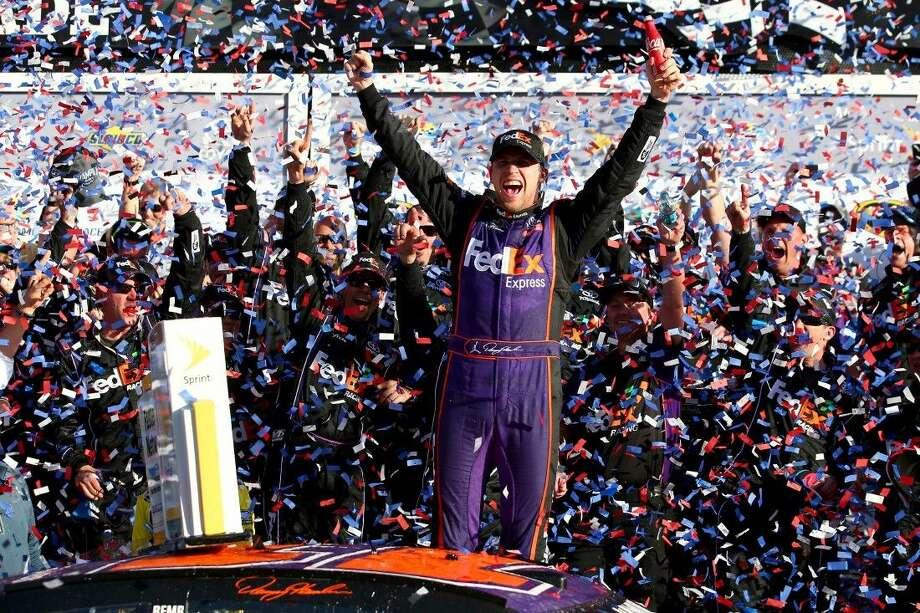 Denny Hamlin celebrates in Victory Lane after winning the NASCAR Sprint Cup Series DAYTONA 500 at Daytona International Speedway on Sunday in Daytona Beach, Florida. Photo: Sarah Crabill
