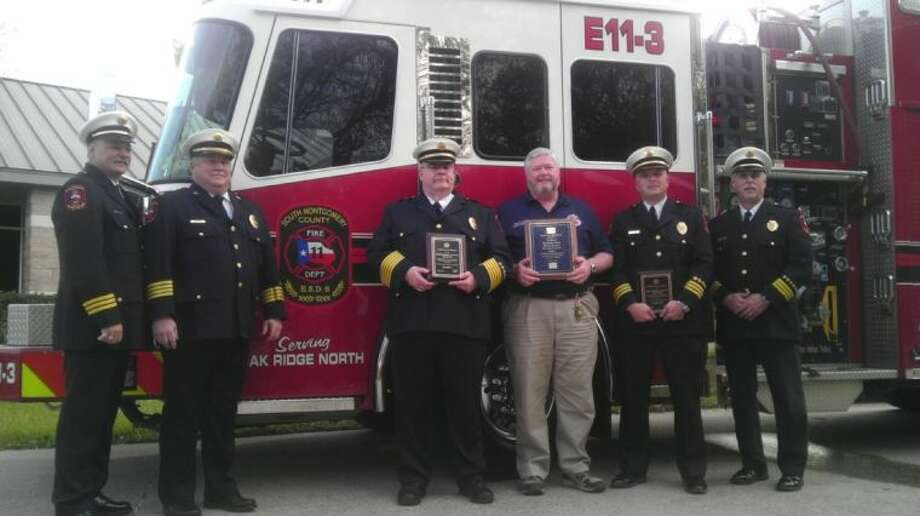 Members of the South Montgomery County Fire Department proudly display a plauqe commemorating their Class 1 Insurance Services Office rating following a presentation at Oak Ridge North City Hall Wednesday evening. From left to right: Cpt. John Bradley; Assistant Fire Chief Michael Johnson; Fire Chief Robert Hudson; Commissioner James Kelly; Deputy Chief Clint Cooke; and Deputy Chief Tommy Erickson.
