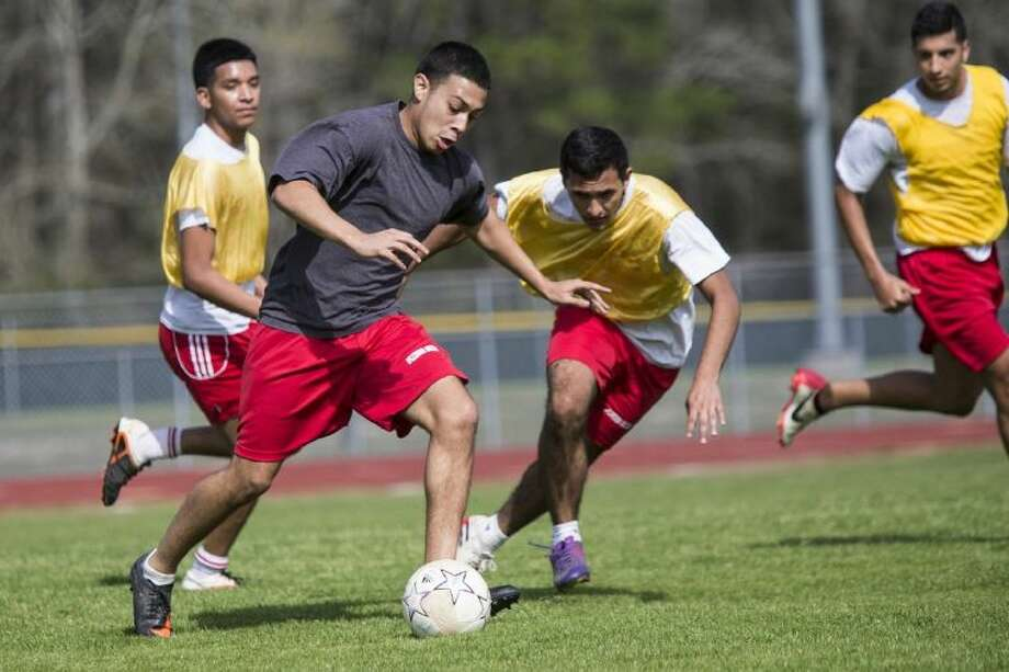 Splendora's Chris Melendez dribbles upfield during practice on Wednesday. The Wildcats finished 12-0 in District 37-4A play this season.
