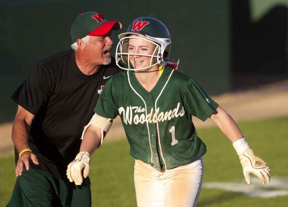 The Woodlands' Aubrey Leach celebrates with coach Richard Jorgensen after hitting a grand slam in the first inning against Conroe. To view or purchase this photo and others like it, visit HCNpics.com. Photo: Jason Fochtman