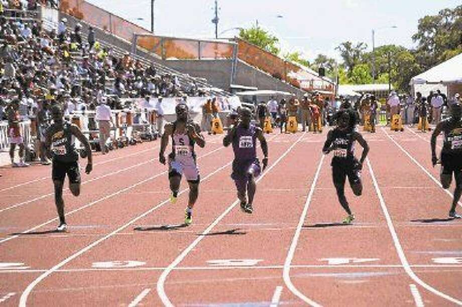 Willis sprinter John Lewis, center, wins the Division II 100-meter dash at the Texas Relays on Saturday.