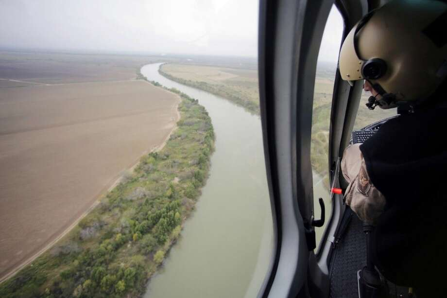 In this Feb. 24, photo, U.S. Customs and Border Protection Air and Marine agents patrol along the Rio Grande on the Texas-Mexico border near Rio Grande City, Texas. Photo: Eric Gay