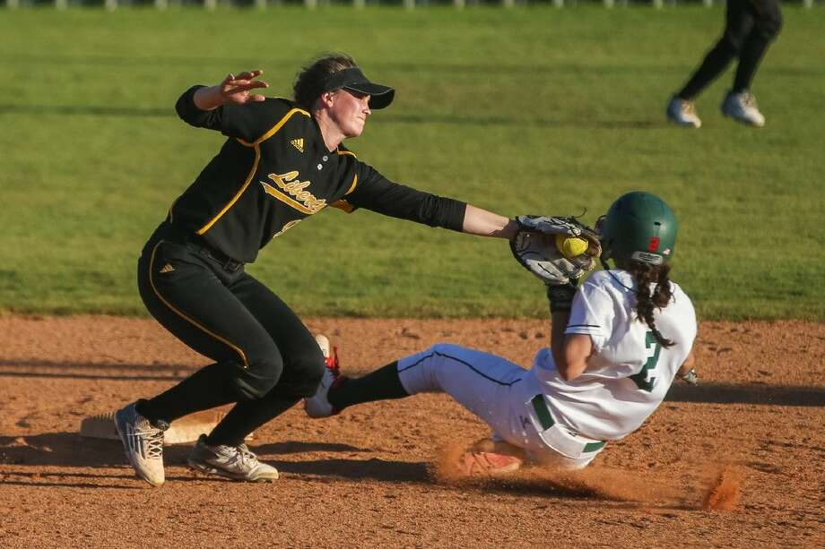 Liberty's Kamryn Parker tags The Woodlands' Abby Jones as she steals second base on Friday at The Woodlands High School. Photo: Michael Minasi