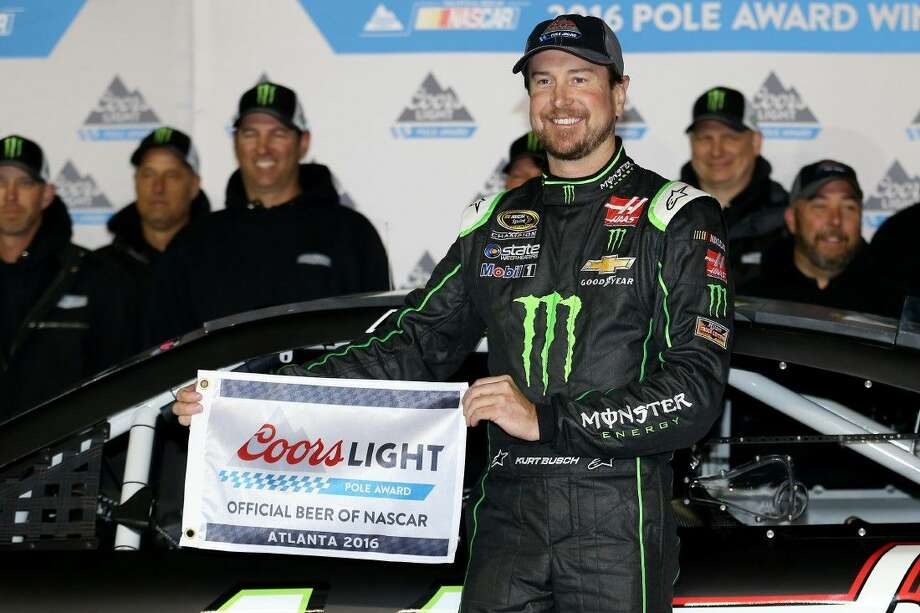 Kurt Busch poses with the Coors Light Pole Award after qualifying for pole position for the NASCAR Sprint Cup Series Folds of Honor QuikTrip 500 at Atlanta Motor Speedway on Friday in Hampton, Georgia. Photo: Matt Hazlett