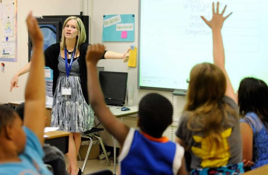 In this Oct. 1, 2013, photo, Amy Lawson, a fifth-grade teacher at Silver Lake Elementary School in Middletown, Del., teaches an English language arts lesson. The school has begun implementing the national Common Core State Standards for academics.