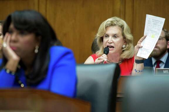 House Financial Services Committee member Rep. Carolyn Maloney, D-N.Y., right, questions Wells Fargo CEO John Stumpf on Capitol Hill in Washington, Thursday, Sept. 29, 2016, during the committee's hearing investigating Wells Fargo's opening of unauthorized customer accounts. Fellow committee member Rep. Terry Sewell, D-Ala. is at left.  (AP Photo/Cliff Owen)