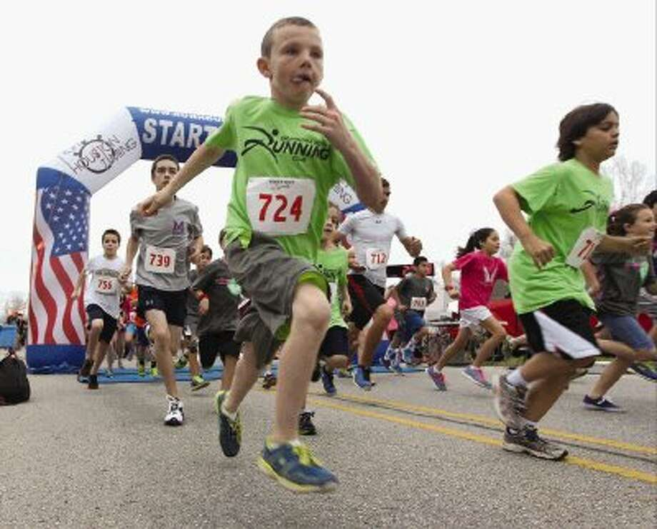 Runners take off during the 2nd annual Angel Run at Lone Star Community Center Saturday. To view or purchase this photo and others like it, visit HCNpics.com. Photo: Jason Fochtman / Conroe Courier