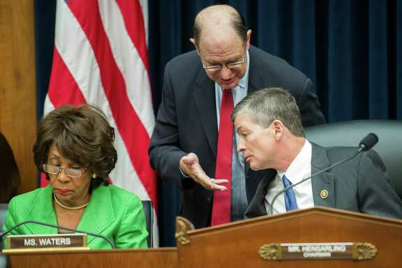 House Financial Services Committee Chairman Jeb Hensarling, R-Texas, right, talks with Rep. Brad Sherman, D-Calif., center, as the committee's ranking Member Maxine Waters, D-Calif. goes over notes at left, on Capitol Hill in Washington, Thursday, Sept. 29, 2016, prior to the start of the committee's hearing investigating Wells Fargo's opening of unauthorized customer accounts.  (AP Photo/Cliff Owen)