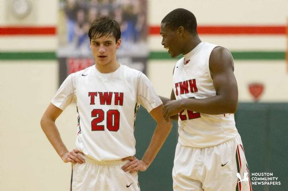 The Woodlands small forward Romello Wilbert, right, talks with guard Clay Creighton during the third quarter of a District 16-6A boys basketball game Jan. 19. To purchase this photos, and others like it; go to HCNpics.com. Photo: Jason Fochtman