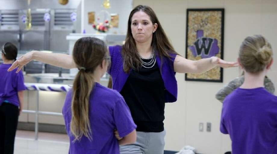 Brabham Middle School teacher Tiffany Bird instructs students in dance as the assistant director for the Sophistikats Dance Team and also teaches math to eighth-graders. Bird was awarded the Willis ISD MVP Award at Wednesday night's board of trustees meeting.