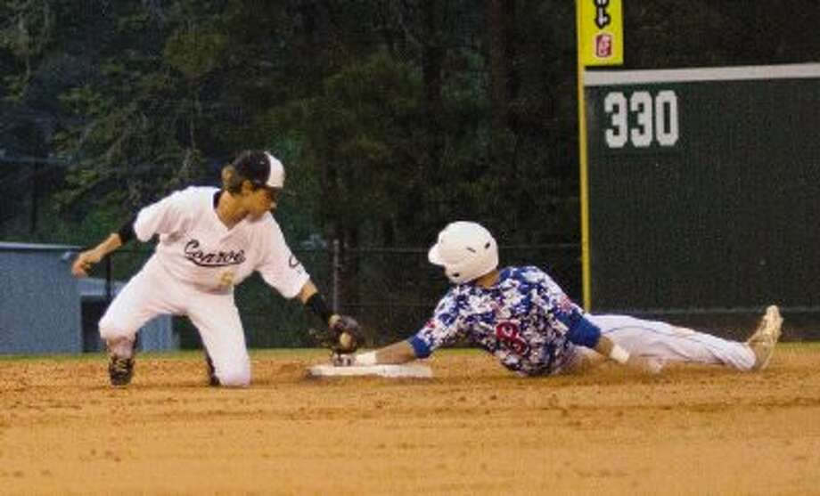 Conroe's Dawson Shibley tags out Oak Ridge's Zachary Rollins as he slides past third base during a District 14-5A game at Ferrell Park at Elmore Field on Friday night. Oak Ridge won 4-0. To view or purchase this photo and others like it, visit HCNpics.com. Photo: Staff Photo By Ana Ramirez / The Conroe Courier