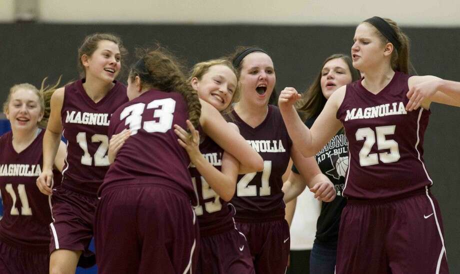 Magnolia players celebrate winning a Region III-5A area playoff game at Blinn College in Brenham last Thursday. On Tuesday night, the Lady Bulldogs advanced to the region semifinal after a 45-41 win over Waco. Photo: Jason Fochtman