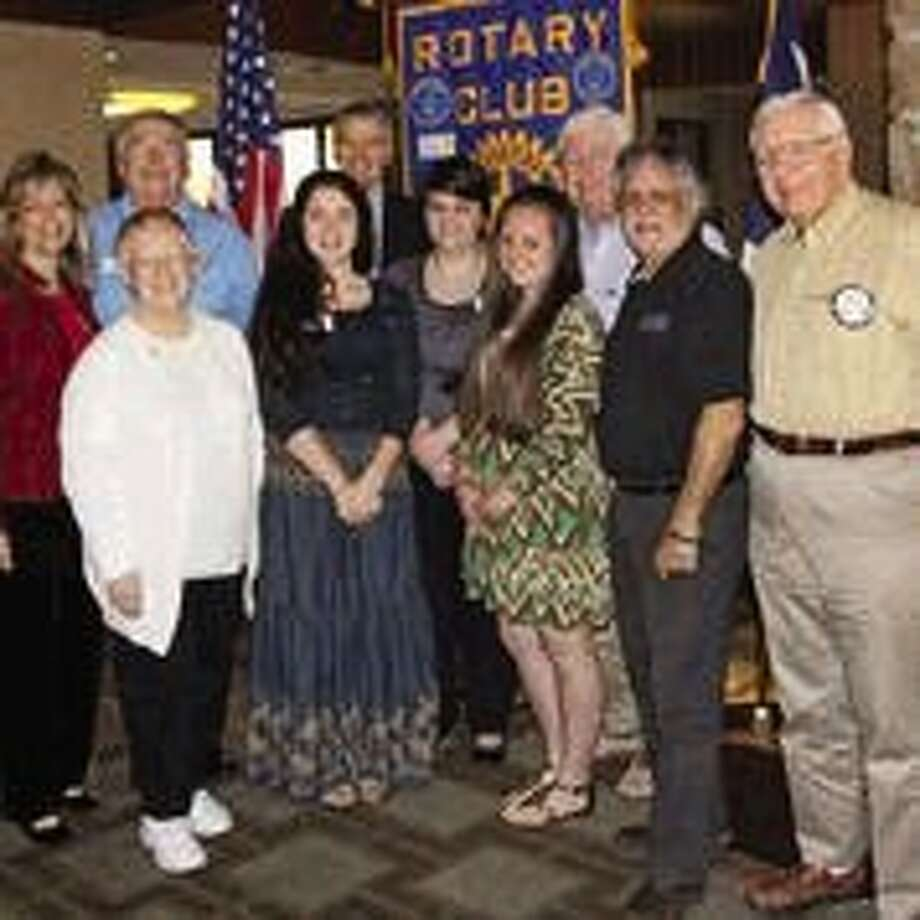 Members of the Rotary Club of Lake Conroe Literacy Committee and Rotarian judges gather around the three winners of the club's first Four-Way Test Speech Contest. The students are from Willis and Montgomery ISD. The three student winners, center, are : Kiah Jones, MISD, Jessica Green, MISD, and Tana McClellond, WISD.