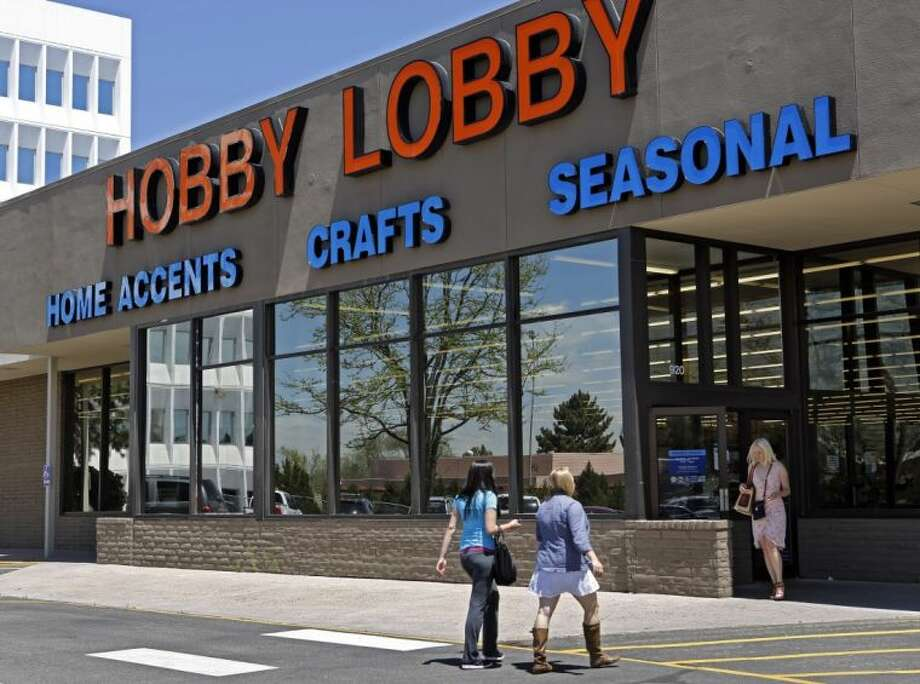 In this May 22, 2013, customers enter and exit a Hobby Lobby store in Denver. The Obama administration and its opponents are renewing the Supreme Court battle over President Barack Obama's health care law in a case that pits the religious rights of employers against the rights of women to the birth control of their choice. Two years after the entire law survived the justices' review by a single vote, the court is hearing arguments on Tuesday in a religion-based challenge from family-owned companies that object to covering certain contraceptives in their health plans as part of the law's preventive care requirement. The largest company among them, Hobby Lobby Stores Inc. Photo: Ed Andrieski