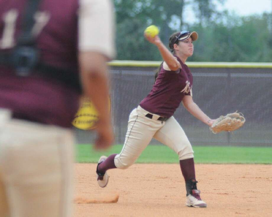 Magnolia West's Torri Hendrick fires across the diamond against Magnolia in a District 19-5A contest at Magnolia High School on Tuesday. Photo: Keith MacPherson
