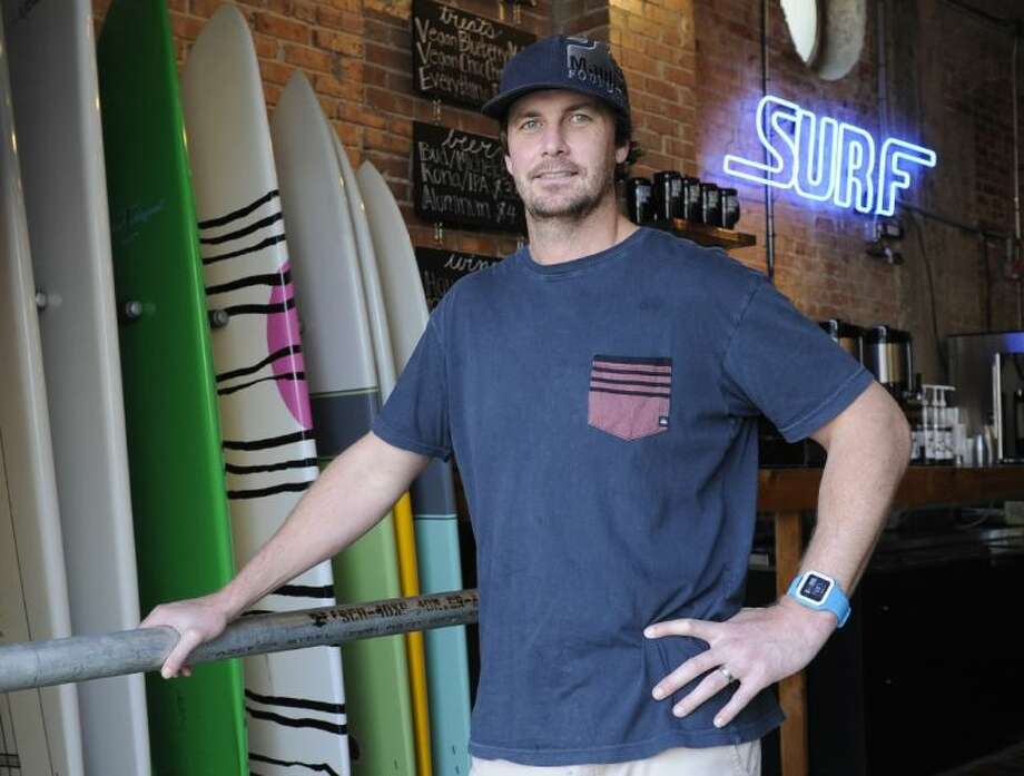 Damien McDonald stands in his Texas Surf Co. shop in Galveston, Texas on Thursday, March 20, 2014. McDonald nearly scrapped his plans to open a second surf shop in Galveston when he learned he'd have to pay more than 8,000 annually in flood insurance. President Barack Obama signed a law rolling back steep hikes that took effect almost overnight as a result of a 2012 law, but the legislation still imposes mandatory annual price increases of 25 percent on businesses and second homes until the owners switch from a subsidized rate to one based on the real risk of flooding. Photo: Pat Sullivan