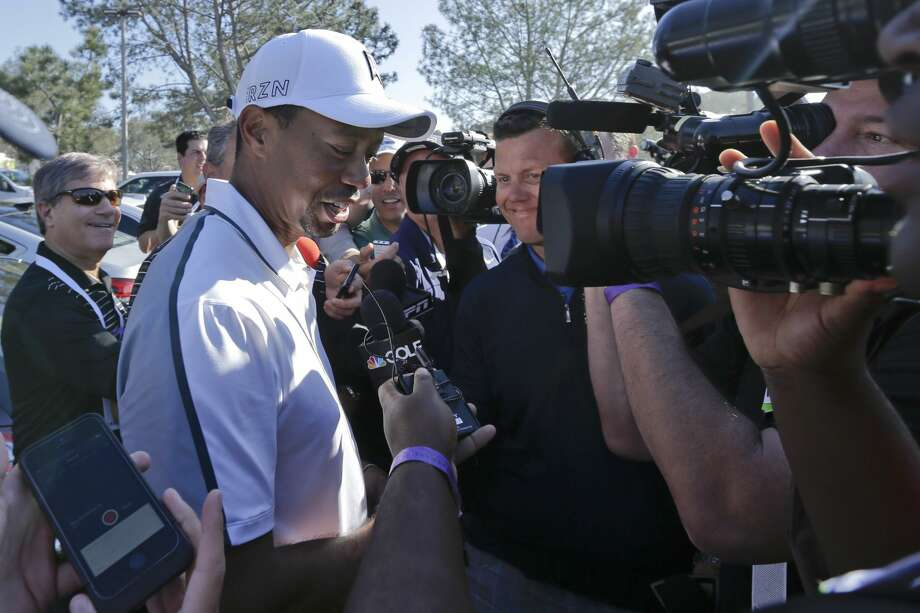 FILE - In this Feb. 5, 2015, file photo, Tiger Woods speaks to reporters after withdrawing during the first round of the Farmers Insurance Open golf tournament in San Diego. Woods won't be at Bay Hill next week for the Arnold Palmer Invitational. He still isn't ruling out the Masters. Woods said on his website Friday, March 13, 2015, that he will not play at the tournament he has won eight times. (AP Photo/Gregory Bull,, File) Photo: Gregory Bull