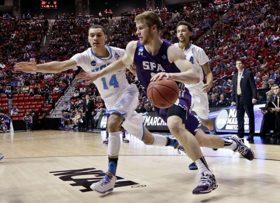 Stephen F. Austin's Thomas Walkup drives the baeline against UCLA guard Zach LaVine. UCLA won 77-60. Photo: Gregory Bull