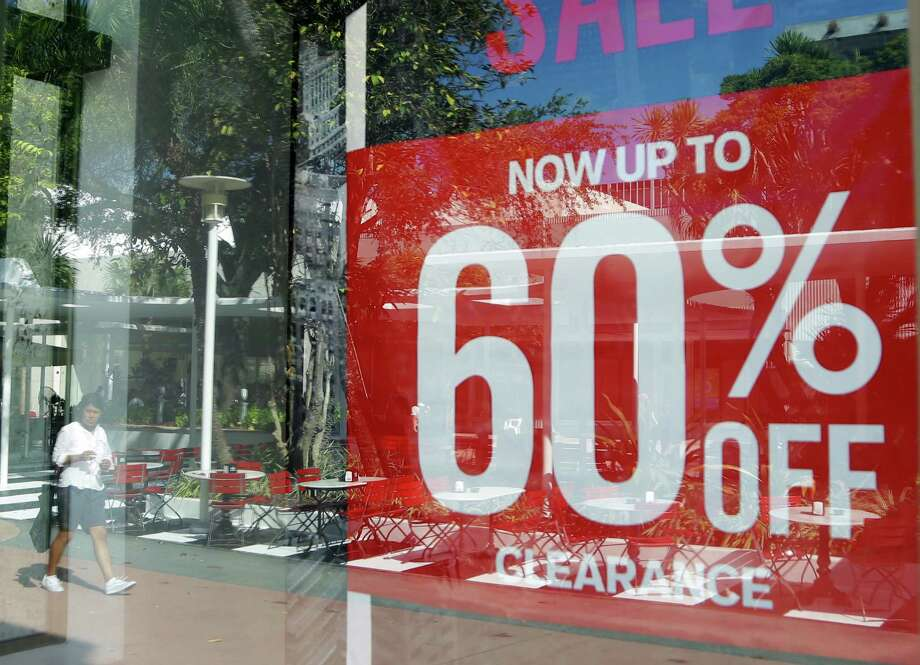 A Miami Beach Express store has a sale. Consumer spending grew 4.3 percent in the second quarter. Photo: Lynne Sladky, STF / Copyright 2016 The Associated Press. All rights reserved.