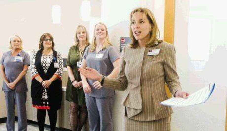 Debbie Sukin, CEO of Houston Methodist's Woodlands hospital, speaks to guest during the opening of the hospital's breast care center Friday. Photo: Jason Fochtman