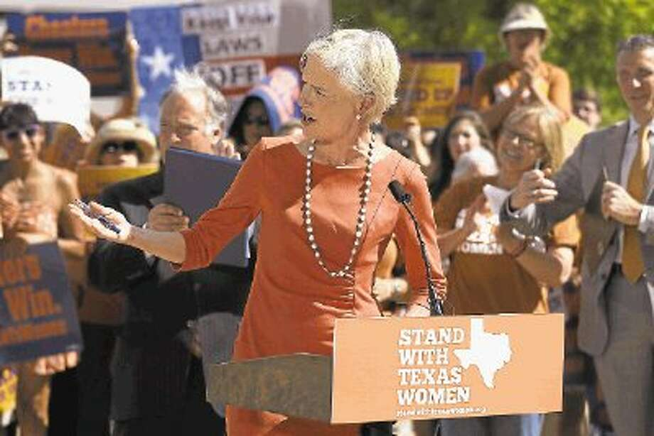 In this July 10, 2013 photo, Cecile Richards, president of Planned Parenthood Action Fund, rallies a crowd as she delivers comments in front of the Dallas City Hall. / @WireImgId=2668367