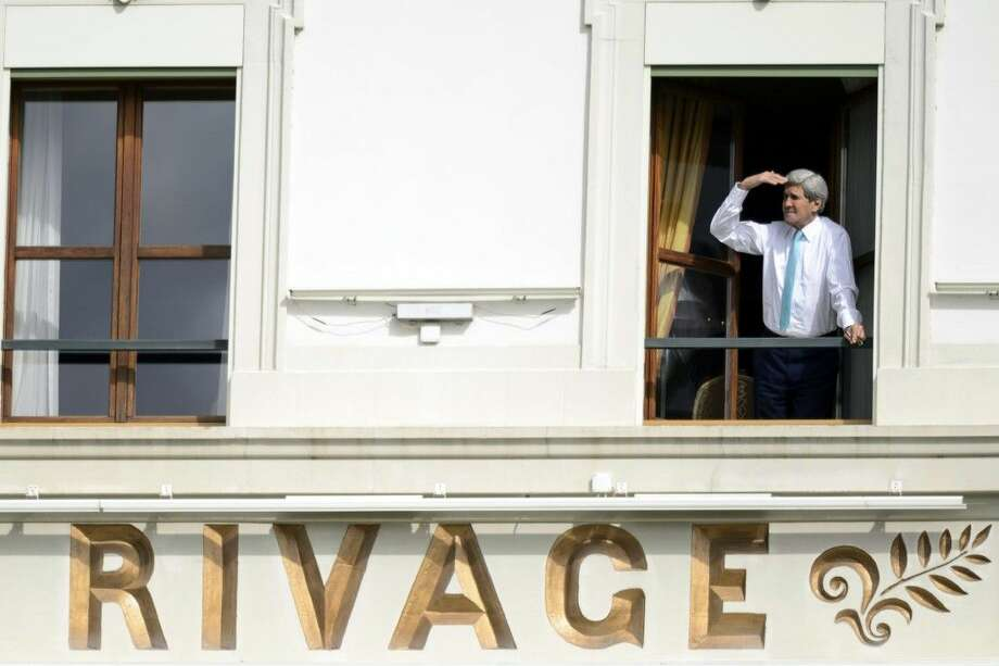 U.S. Secretary of State John Kerry looks toward Lake Geneva from the window of his hotel room as negotiations for a nuclear deal with Iran continued Wednesday in Lausanne, Switzerland. Photo: Laurent Gillieron