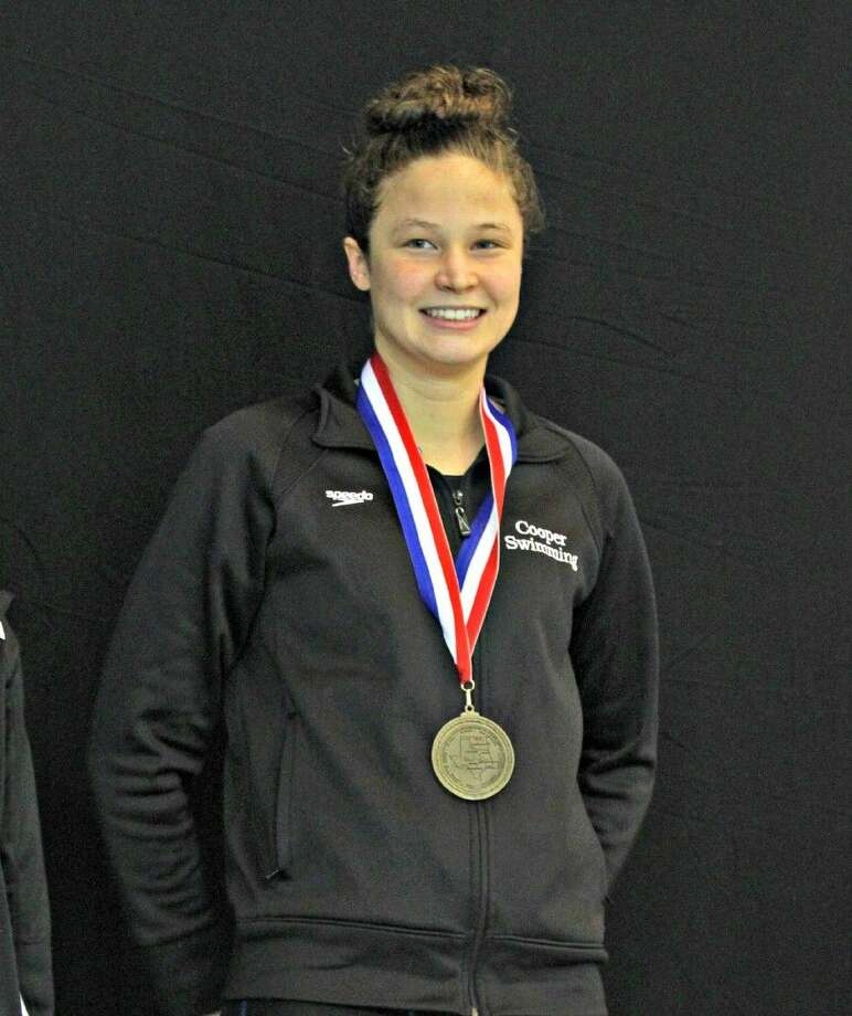 The John Cooper School's Grace Ritch won SPC titles in the 500-yard freestyle and 100-yard butterfly.