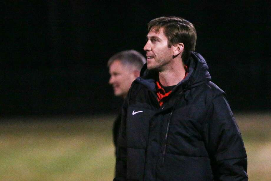 Caney Creek head coach Andrew McGregor looks on during the high school boys soccer game against Huntsville this past Friday. Photo: Michael Minasi
