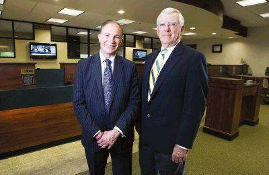 F. Scott Dueser, chairman, president and CEO of First Financial Bankshares, left, and Sam Baker, president and CEO of First Bank, jointly announced Wednesday First Financial's acquisition of First Bank. Photo: Jason Fochtman
