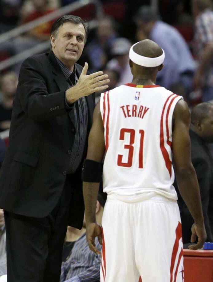 Houston Rockets coach Kevin McHale talks with Jason Terry in the first half against the Sacramento Kings Wednesday in Houston. Photo: Pat Sullivan