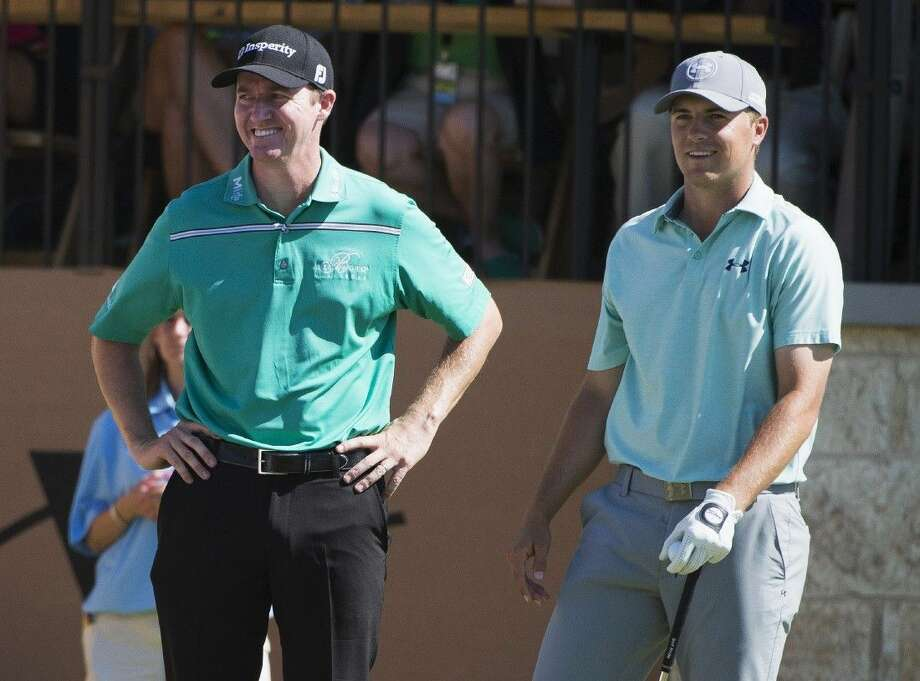 Jimmy Walker, left, and Jordan Spieth talk on the 16th tee during the final round of the Valero Texas Open golf tournament, Sunday in San Antonio. Walker won the tournament. Photo: Darren Abate