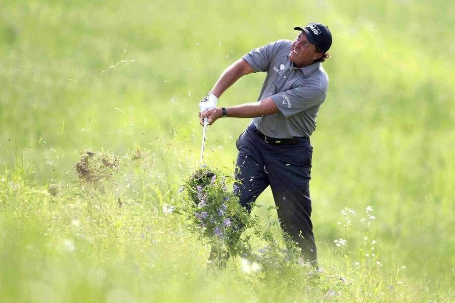 Phil Mickelson hits out of the rough for his second shot on the 17th hole during the second round of the Shell Houston Open at the Golf Club of Houston on Friday in Humble. Photo: Jason Fochtman