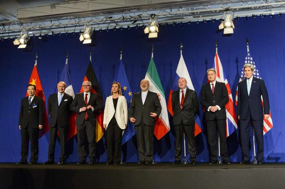 From left, China's Wang Qun, France's Laurent Fabius, Germany's Frank-Walter Steinmeier, the European Union's Federica Mogherini, Iran's Mohammad Javad Zarif, an unidentified Russian delegate, Britain's Philip Hammond and U.S. Secretary of State John Kerry. Photo: Jean-christophe Bott