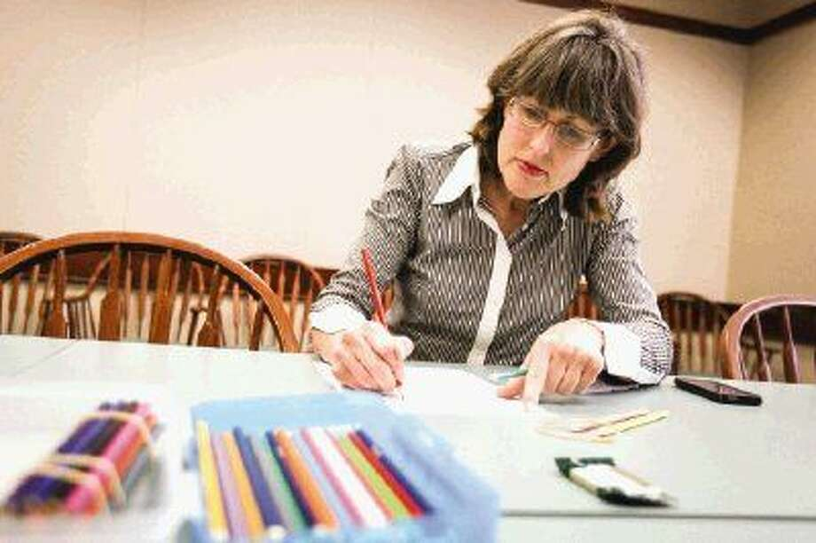 Conroe resident Kristi Eppright participates in a stress-relieving adult coloring session on Jan. 29 at Montgomery County's Central Library in Conroe. Photo: Michael Minasi