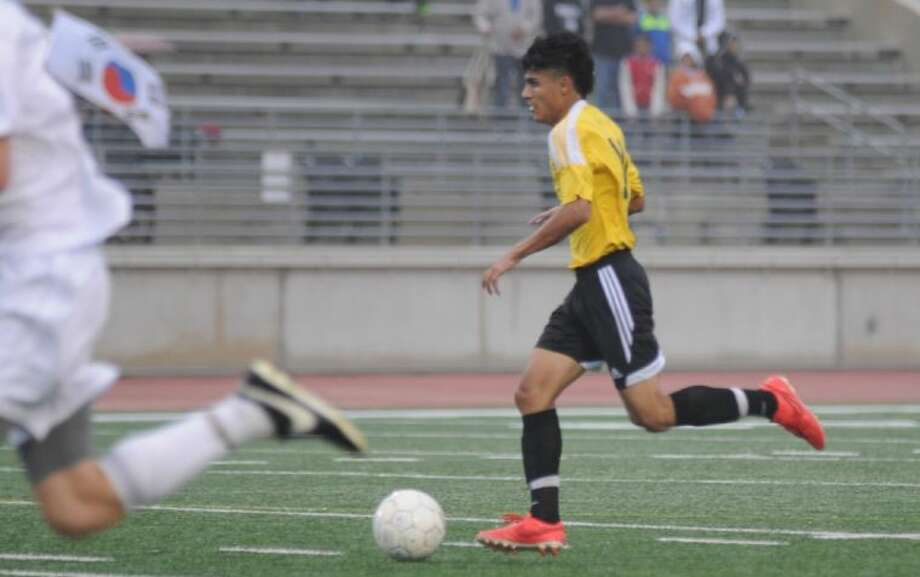 Conroe's Luis Carmona brings the ball upfield against Kingwood in the Region II-5A bi-district playoffs on Thursday at Turner Stadium in Humble. The Tigers won 2-1. Photo: Keith MacPherson