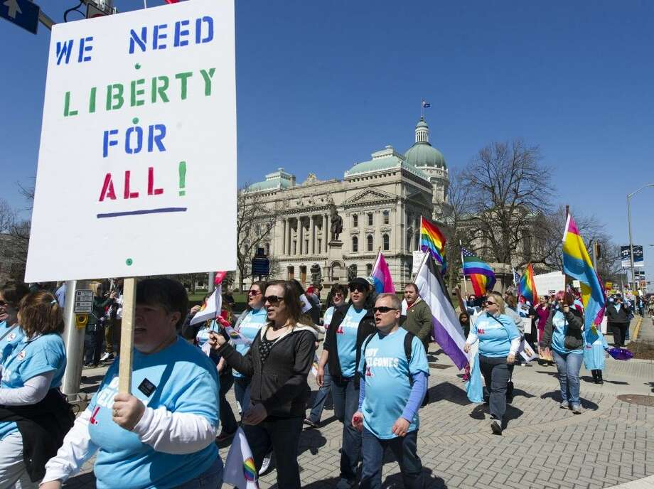 Opponents of Indiana Senate Bill 101, the Religious Freedom Restoration Act, march past the Indiana Statehouse en route to Lucas Oil Stadium on Saturday in Indianapolis. Photo: Doug McSchooler
