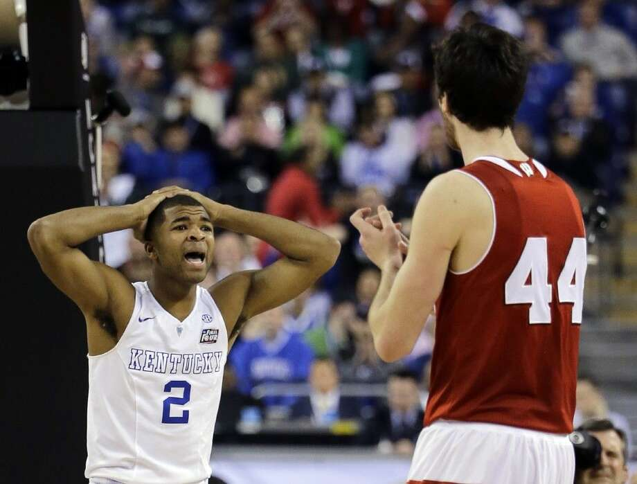 Kentucky's Aaron Harrison reacts to a call during the second half against Wisconsin Saturday in Indianapolis. Photo: David J. Phillip