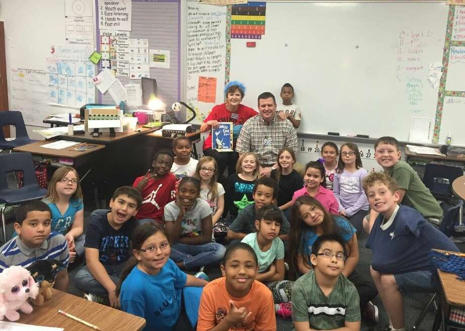 In honor of Dr. Seuss's birthday, over 30 Conroe Noon Lions Club members read to the classes of their adopted school, Reaves Elementary. Pictured with Mrs. Werner's 3rd grade class is Lion Warner Phelps with his mom and retired principal Doris Phelps.