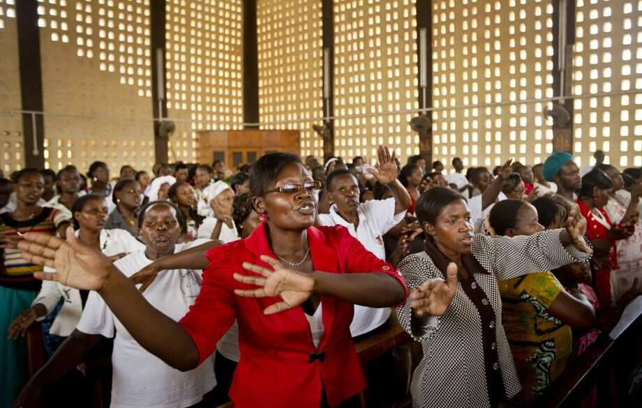 Christians sing during the service at the Our Lady of Consolation Church, which was attacked with grenades by militants almost three years ago, in Garissa, Kenya Sunday. Photo: Ben Curtis