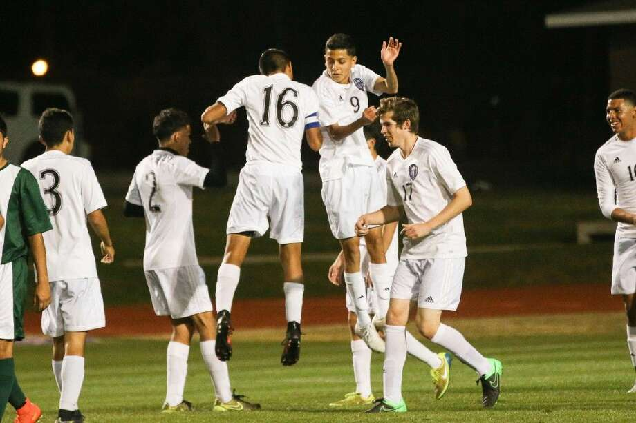 Willis' Andy Reyes (9) celebrates with teammates after scoring a goal during the high school boys soccer game against Livingston on Friday at Berton A. Yates Stadium. To view more photos from the game, go to HCNPics.com. Photo: Michael Minasi